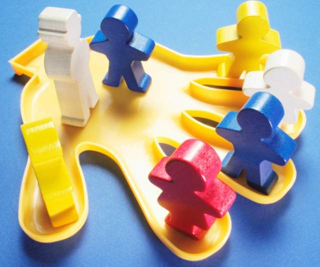 plastic-hand-with-wooden-figures